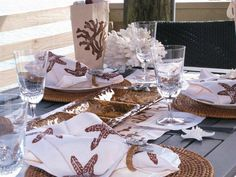 Living beside the sea doesn't always mean aqua, blues and greens - here's an idea for a pretty coastal table scape using chocolate brown linens for fall! (yes, they are available online at Caron's Beach House!)http://www.caronsbeachhouse.com/servlet/the-Dining-and-Entertaining-cln-Table-Linens/Categories