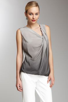 "Draped Silk Top in charcoal by Robert Rodriguez. $245 - $59 at HauteLook. - Asymmetrical neck - Pleated front - Ombre detail - Draped front hem - Approx. 26"" length Fit: this style fits true to size. Model's stats: - Height: 5'9"" - Bust: 32.5"" - Waist: 23"" - Hips: 34"" Model is wearing size 4. Dry clean 100% silk"