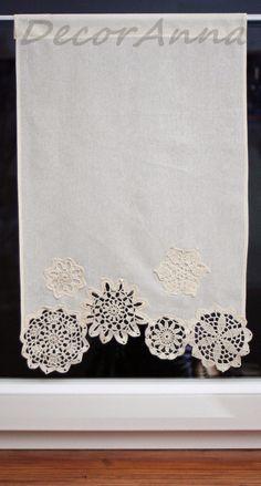 Ecru curtain with crochet doilies