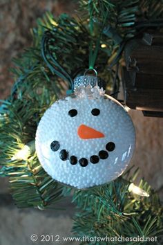 Snowman Ornament plastic ornament disc filled with polystyrene pellets (used for blown insulation) and painted. Simple.