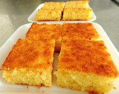 1 prato fundo de mandioca crua ralada 1 prato de queijo ralado 1 pacote (100 g) de coco ralado grosso 2 colheres (sopa) bem cheias de margarina 1 caixa de creme de leite 2 xícaras (chá) de açúcar 2 xícaras (chá) de leite 1 colher (sopa) fermento em pó 6 ovos ligeiramente batidos Comentários comments