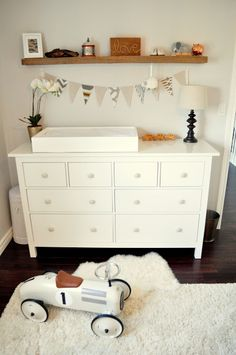 Ikea Hemnes 8-drawer dresser - with painted gray knobs. Love this for the nursery!  Also, that metal roadster from Indigo is the cutest!