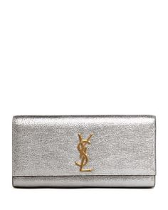 Cassandre Metallic Logo Clutch Bag, Silver by Saint Laurent at Neiman Marcus.