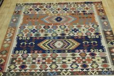 Item No : R-5137  Style : Kilim  Province : Turkey  Made In : Turkey  Foundation : Wool  Pile : 100% Wool  Colors : Rust,Blue, Purple, Ivory, Gold, Green, Brown  Size in Feet : 8' 9'' X 8' 3''  Size in CM : 267 X 251  Shape : Square  Age : 30-35 Years Old  Condition : Very Good  Woven : Hand Woven
