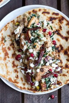 Flavorful chicken, couscous, pomegranate and goat cheese make these wraps (tacos?) worth making. #Tacos #TacoTuesday #Shwarma