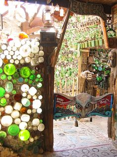 Tinkertown    Grandma Prisbrey directly inspired other people to create their own bottle houses. Ross Ward was one who saw Bottle Village in the 60's and then went on to create Tinkertown near Albuquerque, New Mexico. The buildings house a museum of his handcarved figures and animated scenes.