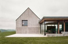 This house with two chimneys was built by Onix Architects in Bosschenhoofd in the Netherlands. Clad in naturally finished wood, the home has a light, crisp look that contrasts with the weathered facade of the old farmhouse, now used as a studio. The modern addition nonetheless features traditional elements such as a saddleback roof and …