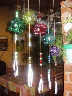 Hanging ornaments made with plastic bottles. I am thinking about sun catchers and wind chimes...