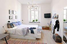 Simple apartment decorating - white bed, purple lavender in the corner
