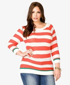 An open-knit sweater featuring a colorblocked pattern. Boat neckline. 3/4 raglan sleeves.
