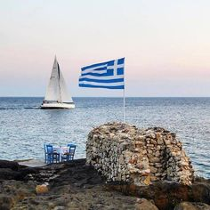 The Greek flag and behind the ship