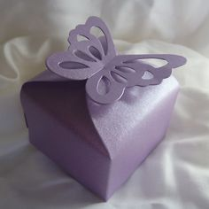 Small presents for all attendees in boxes like this at each place setting