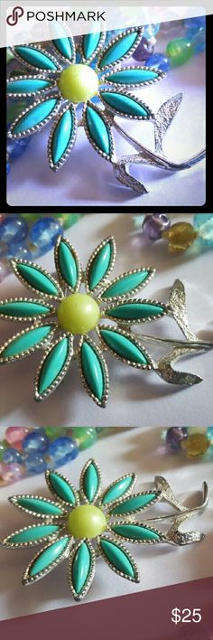 VTG Sara Coventry Enamel Flower Brooch Beautiful turcoise enamel flower brooch. It looks like a daisy. It has a silver tone stem and leaf with a yellow enamel center. Mint condition. Signed Sarah Coventry. Vintage Jewelry Brooches