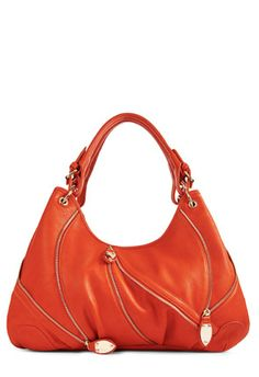 I like this purse, but I like it in blue! The coral/orange/poppy color of this particular bag is just not working for me...