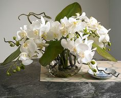 Phalaenopsis orchids – naturally the centre of attention. Expertly arranged for balance, harmony and visual effect, our realistic and meticulously crafted artificial phalaenopsis orchid centrepiece is a beautifully realistic representation. Silk flowers from Bloom.uk.com