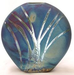 Interesting use of Raku metalic glaze