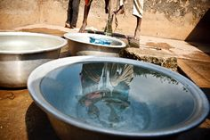 Children fill containers with water from a communal foot-activated pump in Cote d'Ivoire.   Côte d'Ivoire continues to recover from the violence that erupted after the November 2010 presidential election. Over 185,000 people are still displaced, while more than 163,000 Ivoirians remain refugees. UNICEF continues to support efforts in health,nutrition, water, sanitation and hygiene, education and child protection. © UNICEF/Olivier Asselin - http://www.unicef.org/photography