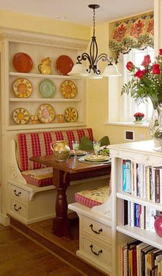 Love this breakfast nook...no place for a nook and I love the bookshelf: storage for all my cookbooks!