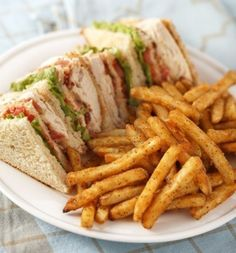 Every ones favorite-The Traditional #Clubsandwich with cooked #chicken , along with egg layered between three slices of toasted bread served with crisp fries & coleslaw