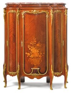 attributed to Roux et Brunet<br>French, active late 19th century<br>A Louis XV style gilt bronze-mounted mahogany, satiné and fruitwood marquetry cabinet <br>France, late 19th century | lot | Sotheby's
