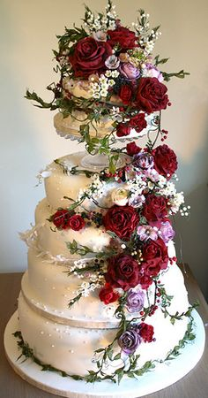 Breathtaking Amy Swann Wedding Cakes - insanely beautiful tall, white wedding cake with a floral topper and cascade of deep burgundy and lavender flowers done to perfection. Beautiful Wedding Cakes, Gorgeous Cakes, Pretty Cakes, Amazing Cakes, Bolo Fack, Fresh Flower Cake, Fresh Flowers, Sugar Flowers, Lavender Flowers