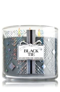 "Black Tie - 3-Wick Candle - Bath & Body Works - The Perfect 3-Wick Candle! Made using the highest concentration of fragrance oils, an exclusive blend of vegetable wax and wicks that won't burn out, our candles melt consistently & evenly, radiating enough fragrance to fill an entire room. Topped with a silver, flame-extinguishing lid! Burns approximately 25 - 45 hours and measures 4"" wide x 3 1/2"" tall."