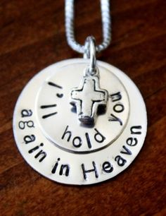 """I'll hold you again in Heaven with cross necklace Silver hand stamped I'll hold you again in Heaven memorial necklace is a great sympathy gift for the loss of a loved one, infant, child, pregnancy or miscarriage.    Sterling silver, hand stamped necklace.  Layered circle charms measure 7/8″- reads """"I'll hold you again in heaven.""""  Select your choice of cross charm or Swarovski crystal birthstone."""
