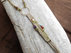 Hand woven necklace with natural linen, gems & brass - spring flowers