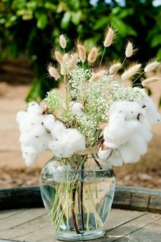 fluffy cotton sprigs look beautiful paired with small flowers, like baby's breath and wheat.