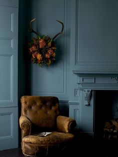 Deep teal walls and fireplace
