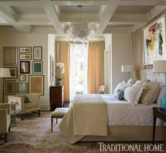 HouseTour:Charleston,SC: Charleston home designed Lisa Hilderbrand! master retreat, traditional elements come to life with the addition of a pop of color from the abstract art and lamps and this incredible light fixture. Note the coffered ceiling.