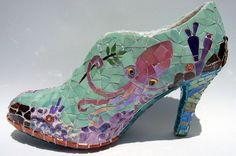 A beautiful art object to cherish but not to wear. Created from a real high heel shoe.    Mosaic shoe sculpture featuring a perky pink octopus on one side and an olive branch toting fish on the other. Coral reef structures are built around the entire shoe. Toe area is lined with copper beads!   Made with stained glass, glazed ceramic, millefiori, rhinestones, glass beads.