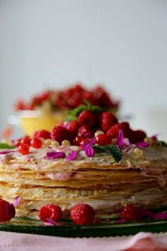 Napolean-Style Crepe Cake with Lemony Filling, Fresh Raspberries, Mint Leaves & Lemon Zest