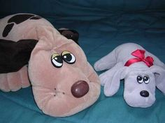 Pound Puppies!! I still have ALL of mine on top of my bookcase. There's a photo of me as a 2-yo dragging around the big brown one!