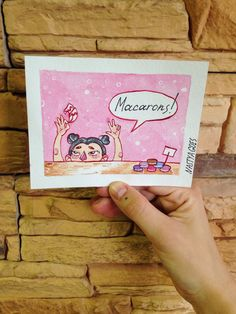 Little watercolor story on the card about little girl who wants to buy some French macaroons