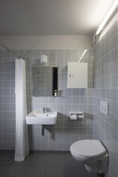 Rural Office for Architecture, New Barn, gray tiled bathroom, Wales | Remodelista