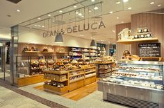 Dean & DeLuca (Supermarket and grocery store) Of Note: the hanging metallic letters Bakery Interior, Retail Interior, Shop Interior Design, Retail Design, Bakery Design, Cafe Design, Restaurant Design, Store Design, Retail Facade