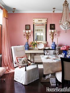 Jane Austen — inspired ballgown curtains and matching silk blend on the walls — Vervain's Caserta Satin — give the dining room its romantic, rose-quartz flush. Design: Kelee Katillac