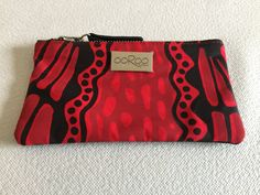 Lily purse featuring Crocodile by Aboriginal artist Aaron McTaggart, Merrepen Arts Aboriginal Artists, Textile Artists, Screenprinting, Crocodile, Red Leather, Lily, Textiles, Australia, Purses
