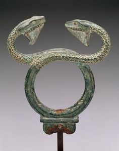 Upper part of a bronze caduceus, snakes twined around a staff.' Carried by Hermes , messenger of the . Also, Hermes' Staff. Dallas Museum of Art - - Χάλκινο κηρύκειο του π. Ancient Greek Art, Ancient Aliens, Ancient Greece, Ancient History, Art Antique, Bronze, Minoan, Hermes, Ancient Artifacts