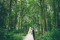 Bride & Groom wedding portrait under trees in a wood/forest, in summer. Guisborough Hall, Stockton on Tees.