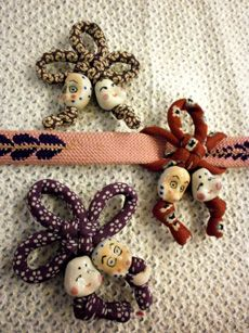 Knotted charms as obidome