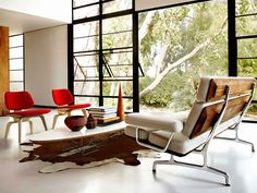 Love this design with the Surfboard table, Eames Sofa and Eames Molded Plywood chairs.