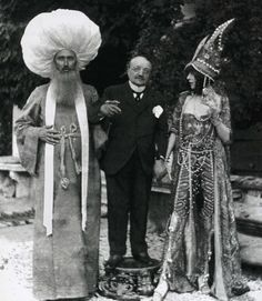 "Artists Paul-Cèsar Helleu and art collector Luisa Casati wearing ""Persian"" costumes, with artist Giovanni Boldini in the garden of Palazzo de Leoni, 1913. Photograph by Mariano Fortuny."