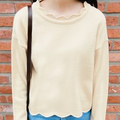 Feast your eyes with this lovable knit sweater! It features a scalloped neckline and hem, dropped shoulders, long sleeves with ribbed cuffs, and a casual fit. Simple yet charming, this sweater would pair well with distressed skinny jeans and black ankle b