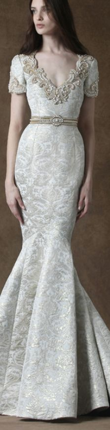 Love the high waisted cut with the belt, the mermaid style and the beading.