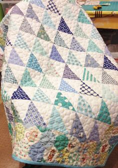 Freda's Hive: baby quilt.  So cute. Look at the hexagon cheater print in the border.  Gives me an idea: add a narrow inner border, actually piece the hexagons and applique the points over the edge of the inner border.