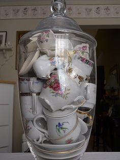 small tea sets under glass - SO inventive!