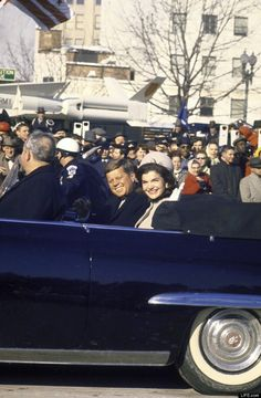 In a photograph that, five decades later, feels at once haunted and familiar, a smiling President and First Lady ride through cheering crowds in the inaugural parade, their very clothes evoking a similar sunny scene enacted less than three years later, in Dallas. ...