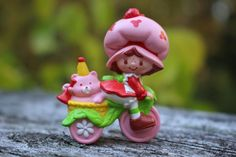 http://www.ebay.com/itm/Vintage-mini-Strawberry-Shortcake-w-Custard-on-bike-miniature-/322004103853?hash=item4af8f0b2ad:m:mg31_Usva41U9o3R4JcChJQ